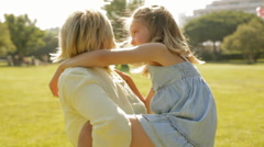 grandmother and granddaughter playing in park - stock footage