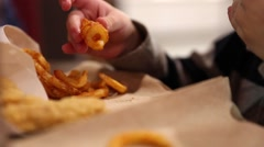 Little boy eating curly fries Stock Footage