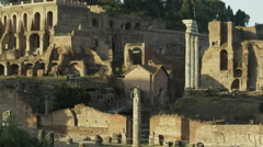 Low angle panning shot of statues and pillars in ancient ruins / Rome, Italy - stock footage