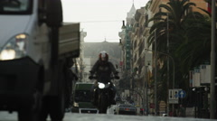 Close up low angle shot of oncoming traffic on busy city street / Rome, Italy Stock Footage