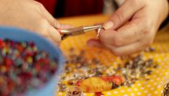 Woman Hands Working Making Beads Rack focus Stock Footage