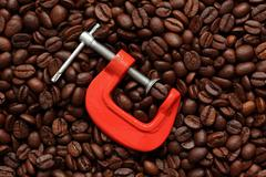 coffee bean in a clamp - stock photo