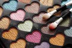 Eyeshadow heart shaped palette with applicators. Stock Photos