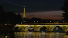 Wide time lapse shot of ferries and bridge near historical landmark / Paris, Stock Footage