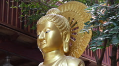 Golden Buddhism statue at the Gangaramaya Temple in Colombo, Sri Lanka Stock Footage