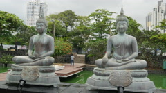 Buddhism statues at the Simamalaka shrine, on an island in Beira Lake, Colombo Stock Footage