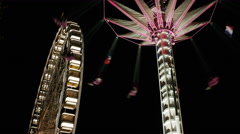 Low angle time lapse view of illuminated carnival rides at night / Paris, France Stock Footage