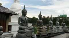 Pan from the Buddhism statues Stock Footage