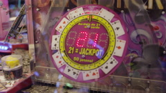 Slow motion shot of gambling slot machine flashing jackpot / Paris, France Stock Footage