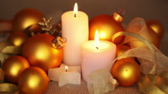 Gold balls and burning candles. seamless loop Stock Footage