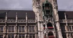 UHD 4K Tourists Attraction Glockenspiel Chimes Bells Music Munich New Town Hall Stock Footage