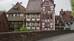 Panning shot of traditional houses and cobblestone bridge in village / Ulm, Stock Footage