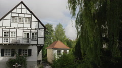Slow motion panning shot of traditional house at river / Ulm, Germany Stock Footage