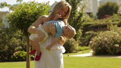 Mother and toddler playing in park. Stock Footage