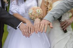 Hands with wedding rings two pairs Stock Photos