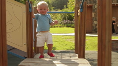 Slow motion of toddler playing on play structure. Stock Footage