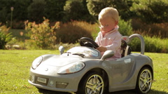 Slow motion of toddler playing in toy car. Stock Footage