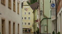 Low angle panning shot of village street / Fussen, Bavaria, Germany Stock Footage