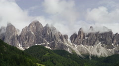 Wide shot of clouds passing over mountains range / Dolomites, Italy Stock Footage