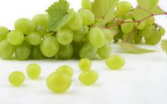 bunch of white grapes isolated on white background with branch vine leaves - stock photo