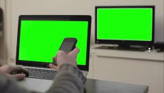 Smartphone hold green screen laptop tv - 1080p Stock Footage