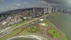 Aerial footage of the tip of Panama City in Cinta Costera Stock Footage