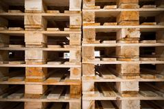 detail of stock wood pallet under sun light - stock photo