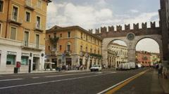 Panning shot of traffic on city street / Verona, Italy Stock Footage