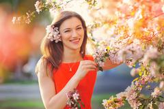 blissful woman enjoying freedom and life in park on spring - stock photo