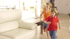Children and parents playing in living room. Stock Footage