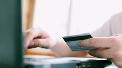 Man is using credit card and laptop  for online payment. FullHD video - stock footage