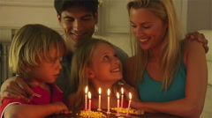 Girl blowing out  candles on birthday cake. Stock Footage
