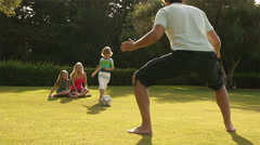 Family playing soccer in garden. Stock Footage