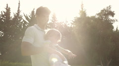 Father playing with his son in garden. - stock footage