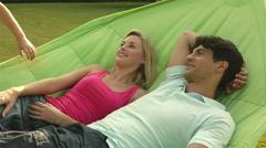 Family in hammock in garden. - stock footage