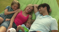 Family in hammock in garden. Stock Footage