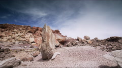 Panning medium shot of upright rock in desert / Emery, Utah, United States Stock Footage