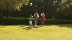 Family playing soccer in garden. - stock footage