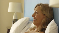Playful couple in bed with rose. Stock Footage