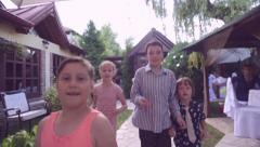 Large group of kids running outdoors. Group of kids playing catch-up Stock Footage