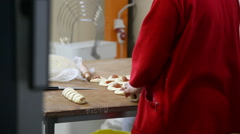 Woman from pieces of dough prepared buns Stock Footage