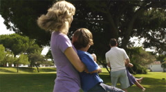 Family playing together in park. - stock footage