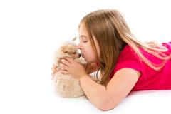blond kid girl with puppy chihuahua pet dog - stock photo