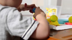 Little boy playing with play dough Stock Footage