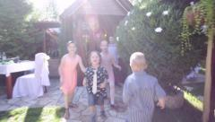 Large group of kids running outdoors. Group of kids playing catch-up - stock footage