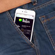 White apple iphone 6 displaying beatles Kuvituskuvat