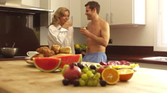 Crane shot of couple eating in kitchen together. - stock footage