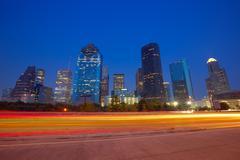 Houston downtown skyline at sunset dusk texas Stock Photos