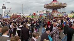 Large Crowd Walking at Oktoberfest in Munich Stock Footage