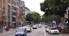 UHD 4K Commuters Commuting Rush Hour Munich City Intersection Cars Traffic Jam Stock Footage